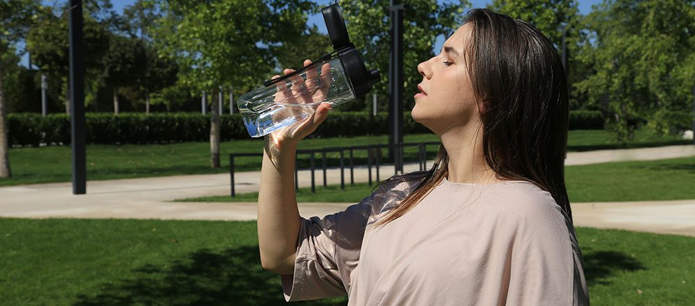 Woman drinking water from a bottle