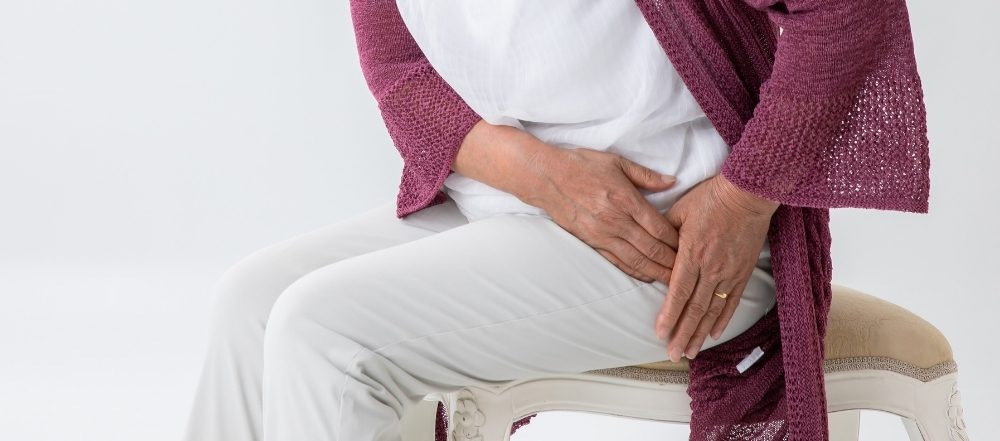 Older woman experiencing pain in her hip